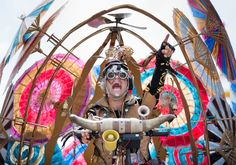 2014 Nebraska State Fair: San Diego performers Mango and Dango and their Flying Umbrella Ship entertain fairgoers on the opening day of the Nebraska State Fair in Grand Island on Friday, August 22, 2014. By: KENT SIEVERS/THE WORLD-HERALD