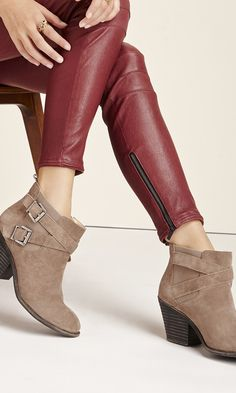 Buckled bootie with a walkable stacked heel, rounded toe and elastic stretch sides for an easy on and off.