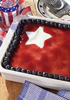Fourth of July Cheesecake -- White star cutouts make this 4th of July recipe stand out on the patriotic holiday dessert table. See for yourself why it gets five-star reviews!