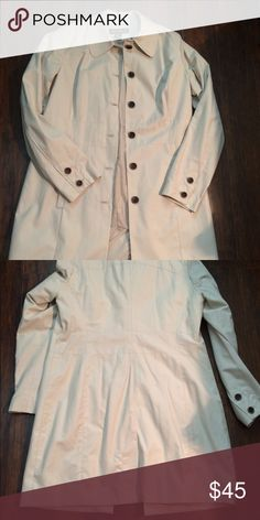 Eddie Bauer Trench Coat NWT Eddie Bauer Trench Coat. Looks great with skinny jeans or slacks. Beautiful coat with a silky lining with beautiful brown and tan buttons! Would look great with brown boots and sweater! Eddie Bauer Jackets & Coats Trench Coats