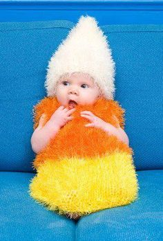 What a cutie pie! Dressed up like a candy corn.