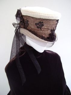 Great crochet top hat with organza byBlackpin. Color it bronze, add a few mechanical decorations, it would be perfect!