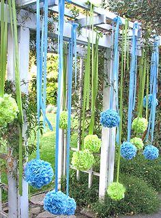 Pom-poms back drop for outdoor wedding decor. http://rosechairdecor.com