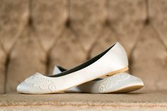 The Barcelona - The reception flat. In Ivory - These are only available in whole sizes. No 1/2 sizes available. If you are between sizes, order the larger of the two sizes. - From what we can tell, these flats run a bit snug. - From the inside this flat measures roughly 24.5cm. Please