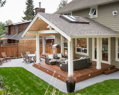 Like the wood over concrete look. No step down out of house. Would have stayed with natural wood look for posts, beams, and fascia.