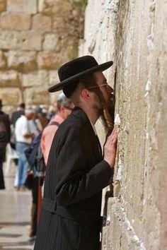 Intimacy between Jew and Western Wall, Jerusalem, Israel