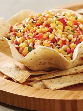 Pampered Chef Mexican Street Corn Salsa: Mexican Street Corn Salsa Ingredients: ½ medium red bell pepper, finely chopped ¼ small red onion, finely chopped ¼ cup (125 mL) cilantro, finely chopped 1 tbsp lime juice 1 can (11 oz or 341 mL) super sweet whole kernel corn, drained* 2 tbsp (30 mL) plain low-fat Greek yogurt ½ oz (15 g) fresh Parmesan cheese, grated (about 2 tbsp/30 mL) ½ tbsp (7 mL) Chipotle