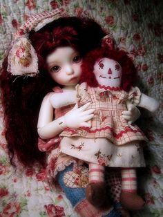 Doll holding raggedy ann doll