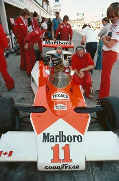 James Hunt (GBR) (Marlboro Team McLaren), McLaren M23 - Ford-Cosworth DFV 3.0 V8 (finished 1st).  With Teddy Mayer (sitting on the left sidepod) and Alastair Caldwell (on the car's left), looking at the M23.  1976 Canadian Grand Prix, Mosport Park