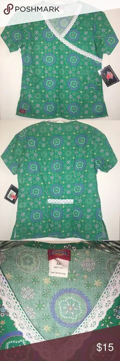 """Dickies Medical Uniform V-Neck Scrub Top 13807A This listing is for a women's multi-color Dickies floralscrub top.  It is brand new,witha blemish along the front hem.  It is a women's size XS.  From the shoulder to the hem is 23"""".   Laying flat, from underarm to underarm is 17.5"""" across.   Do not miss out on this amazing shirt!  Please refer to the measurements for a proper fit. If you have anyquestions, please contact me! Dickies Tops"""
