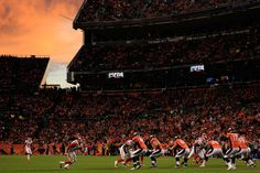 The sun sets on the stadium as the Kansas City Chiefs face the Denver Broncos at Sports Authority Field at Mile High on November 15, 2015 in Denver, Colorado. The Chiefs defeated the Broncos 29-13. (Nov. 14, 2015 - Source: Doug Pensinger/Getty Images North America)
