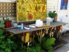 Potting bench with tools hung across the front.