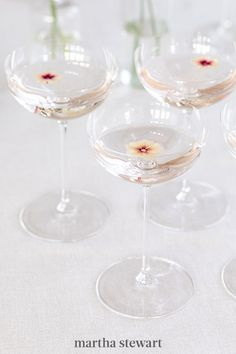 """Delicate coupes filled with Champagne topped off with tiny blooms that coordinate with the groom's boutonniere—will help create a memorable toast for you and a select few. Stafford says, """"I suggest splurging on what the couple is the most passionate about and will be very impactful years to come."""" #weddingideas #wedding #marthstewartwedding #weddingplanning #weddingchecklist Chalk Photography, Classy Hen Party, Wedding Looks, Wedding Fun, Wedding Ceremony, Groom Boutonniere, Linen Rentals, Bride Accessories, Event Design"""