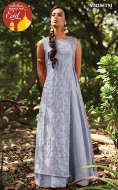 This quintessential Grey anarkali and jacket set by Meena bazaar references the Indian heritage, but gives it a contemporary twist. This festive piece crafted with luscious silks and exquisite zari embroidery, are a perfect addition to festive.It Is paired with matching churidar bottom and net dupatta.Color may slightly be different from the actual item due to photographic lighting sources or the monitor's settings.