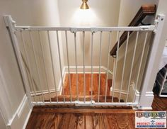 Simple, secure, and beautiful. This custom mounted baby gate installed by Safe Baby Childproofing in Nashville, TN keeps your little ones off the stairs!