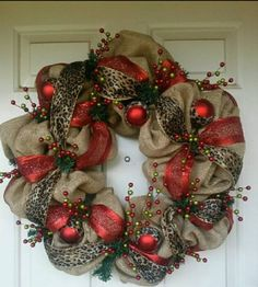 Christmas wreath with red, leopard burlap @Rose Pendleton Pendleton Pendleton Pendleton Englert what if we strung burlap and ribbon through ours?