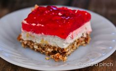 Strawberry Pretzel Salad is a family-favorite addition to so many special occasion meals and you'll always find a large casserole dish with it's sparkling red, strawberry filled top on the buffet for Easter, Southern reunions, and all throughout the summer. It is loved by so many and is always one