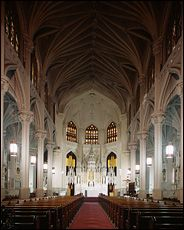"""The interior of St. Thomas the Apostle, on West 118th Street in Harlem. An architectural guide cites its """"berserk eclecticism reminiscent of the filigrees of Milan's cathedral or of many Flemish or Venetian fantasies."""""""