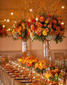 Flower arrangements... Maybe tall branches to break up all of the flowers.