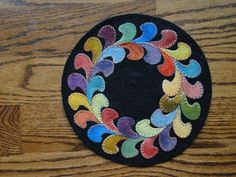 Circle of Feathers Wool Applique Candle Mat Pattern by yogybooboo, $22.00