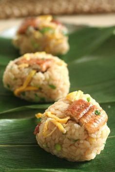 Grilled Eel Mixed Onigiri Rice Ball on Bamboo Leaf, Traditional Japanese Dish