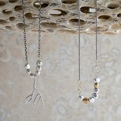 Colby Jue - oak branch and river rock necklaces