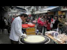 """As profiled in """"The Streets of Heavenly Dumplings,"""" in the June issue of Condé Nast Traveler, when Jean-Georges Vongerichten craves something local and delicious in Shanghai, he heads for the vendors in the French Concession. Here, some scenes from the street show by Andrew Rowat for Condé Nast Traveler."""