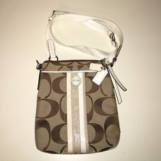 Coach cross body Coach cross body in classic print! Has a patent leather strip and the little coach keychain pictured. Like new, worn a few times! Has a small mark on the back that can't be seen when worn, and the strap has very minimal discoloration from wear. Coach Bags Crossbody Bags