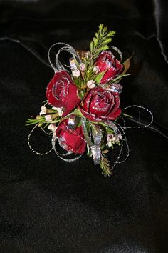 Red rose corsage with silver bling