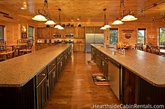 The Big Moose Lodge - The open floor plan allows guests to easily flow from living room, to kitchen, to bedroom without having to break the conversation. The kitchen comes fully equipped with two stoves, two dishwashers, two sinks, full refrigerator, full freezer and ice make. #large #luxury
