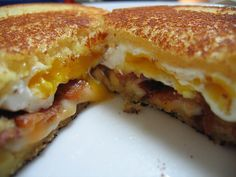 Grilled cheese, bacon and fried egg sandwich