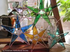 Stained Glass Stars for year-round windowsills or Christmas tree ornaments. Made from upcycled seaglass salvaged from tumbling around in local waters.