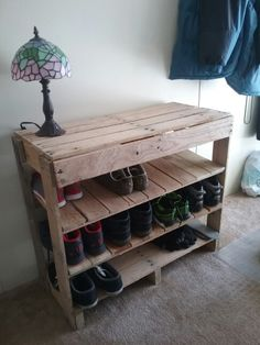 pallet shoe rack made with 2 32x32 pallets and the end pieces from the same