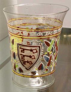 """The Aldrevandini Beaker. Venice ca. 1330. Inscription reads: """"Master Aldrevandin made me."""" Enameled glass. H.: 13 cm.; Dia. 10.9 cm. Possibly influenced by Syrian glass; at one time was considered to be """"Syro-Frankish."""" -- See more at: http://stnelson.com/sca/docs/Aldrevandini_v2.pdf"""
