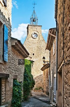 Clock Tower, Ansouis, France View of the clock tower in the Luberon village of Ansouis, dating from the 16th century.