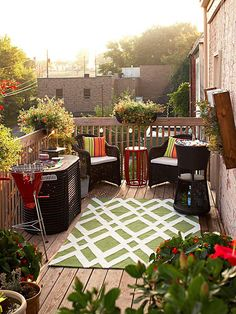 Try using a fun outdoor rug to perk up a patio. More colorful touches for outdoor decorating: http://www.bhg.com/home-improvement/porch/outdoor-rooms/colorful-backyard-decorating-ideas/?socsrc=bhgpin053013rug=13