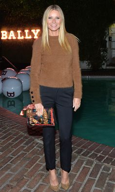 Gwyneth Paltrow in a brown sweater and black pants