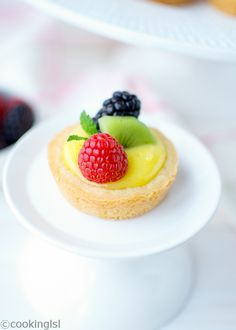 Berry Lemon Tartlets and a Giveaway.Meyer lemon curd and berries on top of shortbread cookie crust.