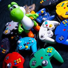 """Morning everyone!! Saw this cool pic of yoshi with controllers and thought """"yes! This is awesome!!"""". What console did you like best nintendo 64 or gamecube? Mine would be the 64 by far. Played oot the other day. #retrogaming #mario #supermario #gamecube #n64 #nintendo64 #amiibo #gamechanger #anime #gamestop #legendofzelda #zelda #luigi #instagamer #nerdalert #girlswhogame #pokemon #pikachu #igersnintendo #gamerguy #instagaming #games #gamer #collector #NintendoSwitch #mariokart #videogames…"""