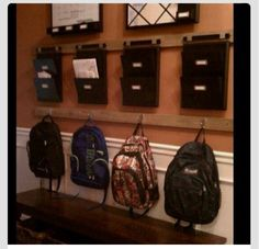 Designated bookbag hooks and homework organizers.