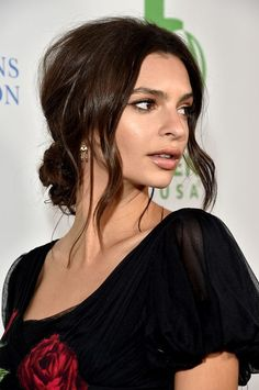 Emily Ratajkowski's Low, Messy Bun > Flop your hair into the pieciest bun right at the nape and don't even think about tucking away your layers. The more lived-in this low knot looks, the better.