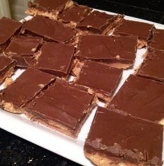 Trisha Yearwood's no bake chocolate peanut butter pretzel bars. Use vegan chocolate and butter.
