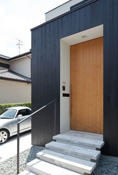 Bewitching Yin Yan House Ideas with Minimalist Decoration Concept: Simple Modern Outdoor Concrete Staircase Of Niu With Simple Black Handrai...