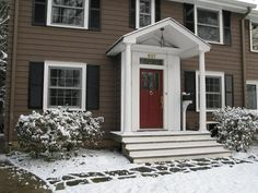 exterior paint schemes for colonial homes - I love the dark with the black shutters and keeping the red door. Exterior Paint Schemes, House Paint Exterior, Exterior Paint Colors, Exterior House Colors, Exterior Design, Siding Colors, Door Paint Colors, Paint Colors For Home, Black Shutters