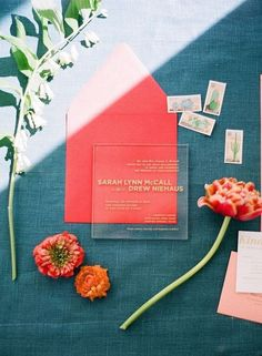 Save this for major acrylic wedding invitation inspiration, like this modern garden acrylic wedding invite accented with pastel envelopes and vintage stamps.