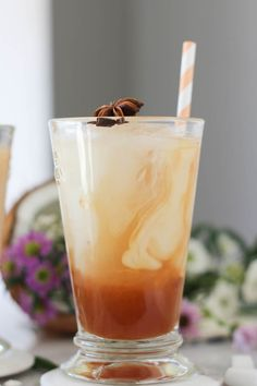 PaleOMG Coconut Thai Iced Tea 4 cups water 4 black tea bags 3 anise stars 1 cinnamon stick 2 whole cloves ⅓ cup maple syrup (or less, to personal taste) 20 drops stevia extract ½ teaspoon vanilla extract For the coconut milk 2 cups Pacific Foods Organic Original Coconut Milk, chilled 2 tablespoons maple syrup ½ teaspoon vanilla extract ½ vanilla bean, cut in half, seeds removed ice