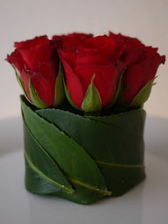 What a wonderful idea - roses in floral foam, with leaves wrapped around the foam. This would make a great centerpiece for a wedding, a holiday table, or for adding a touch of something special for every day. Shop roses year-round in a variety of stem lengths and colors at GrowersBox.com!