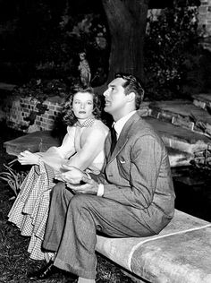 Katharine Hepburn and Cary Grant in conference with George Cukor (not pictured) between takes ofThe Philadelphia Story