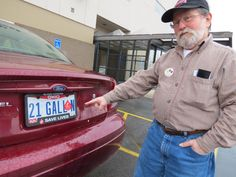 "Blood donor Leo Grilliot of Troy shows his custom license plate, which reads ""21 GALL N,"" on April 7 in downtown Dayton at the Community Blood Center."