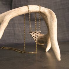 Etched and Cut Out Triangle Wood Necklace by Diamonds Are Evil (I like the antler display stand)